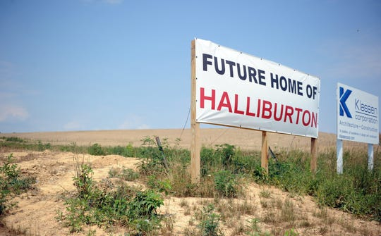 A sign marks the site of the Halliburton facility in Eastpointe Business Park in 2012. Halliburton became one of the largest employers in the county over the past decade.