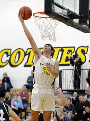 Jakob Frueh goes up for a layup during Tri-Valley's 62-42 win against Granville on Monday night in Dresden.
