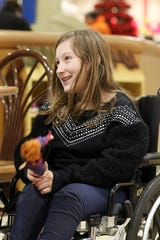 Ava McCulloch smiles as she talks about her future plans recently. McCulloch, 11, has spina bifida, and because her family has had to move out of their home, has largely been confined to a wheelchair.