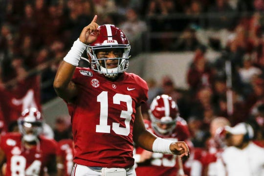 Alabama Crimson Tide quarterback Tua Tagovailoa (13) celebrates after a touchdown during the first half of an NCAA football game against the Tennessee Volunteers at Bryant-Denny Stadium.