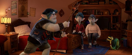 "Metalhead elf Barley Lightfoot (left, voiced by Chris Pratt) tries to conjure his late father as brother Ian (Tom Holland) and mom Laurel (Julia Louis-Dreyfus) look on in Pixar's animated fantasy comedy ""Onward."""