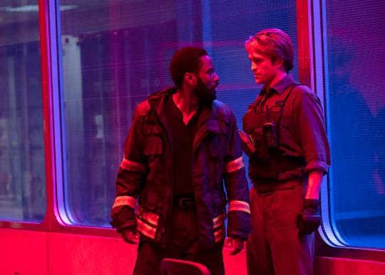 "John David Washington (left) and Robert Pattinson are operatives moving forward and backward in time to save the day in ""Tenet."""