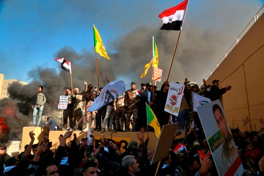 Protesters in front of the U.S. Embassy compound in Baghdad, Iraq, on Dec. 31, 2019.