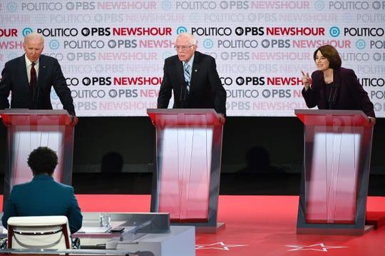 Former Vice President Joe Biden and Sens. Bernie Sanders of Vermont and Amy Klobuchar of Minnesota at the Democratic presidential debate in Los Angeles on Dec. 19, 2019.