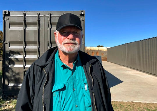 Jack Wilson, 71, poses for a photo at a firing range outside his home in Granbury, Texas, on Monday.