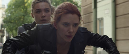 "Natasha Romanoff (Scarlett Johansson, right) reconnects with her ""sister"" Yelena (Florence Pugh) in ""Black Widow."""