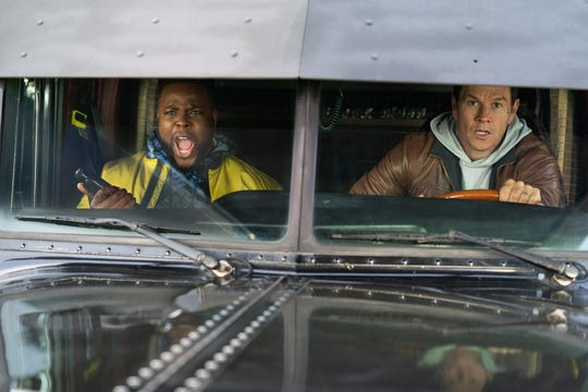 "Spenser (Mark Wahlberg, right) and Hawk (Winston Duke) are an unlikely crime-fighting pair in the Netflix action comedy ""Spenser Confidential."""