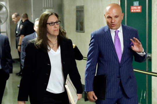 Manhattan Assistant District Attorney Joan Illuzzi, left, and Arthur Aidala, one of Harvey Weinstein's lawyers, leave a hearing on July 11, 2019,  in New York.