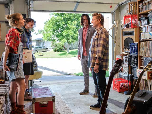 """Daughters Thea (Samara Weaving, from left) and Billie (Brigette Lundy-Paine) help their dads Ted (Keanu Reeves) and Bill (Alex Winter) write a song to save the universe in """"Bill & Ted Face the Music."""""""