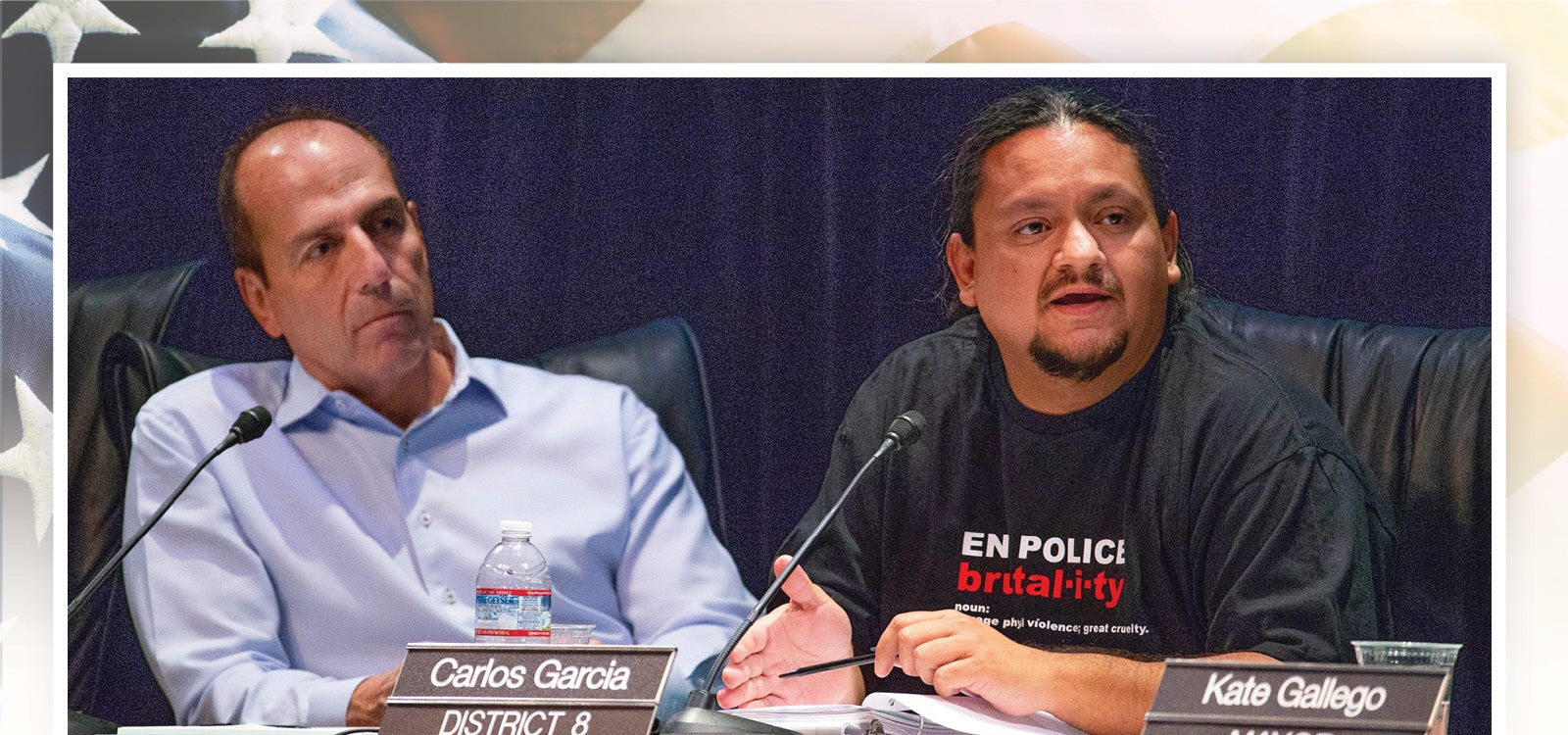 Councilman Carlos Garcia (right) makes a point as the Phoenix City Council conducts a meeting at the Orpheum Theatre in downtown Phoenix, July 2, 2019. Councilman Sal Dicicio listens (left).
