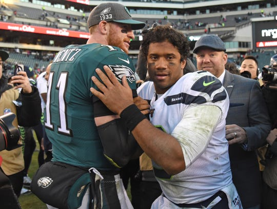 Eagles quarterback Carson Wentz  and Seahawks quarterback Russell Wilson