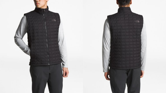 This puffy vest pairs well with other layers.