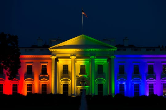 The White House is lit up in rainbow colors after the Supreme Court ruled to legalize same-sex marriage in June 2015 in Washington, D.C.
