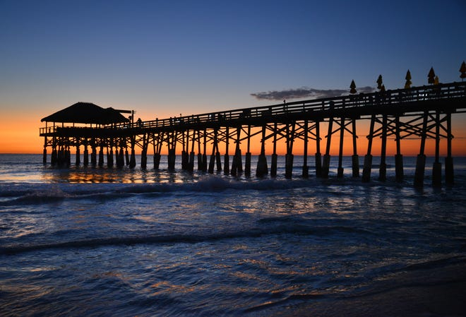 A few fishermen were out on the Cocoa Beach Pier at dawn. People seemed drawn to the Cocoa Beach Pier to watch the first sunrise of 2020.