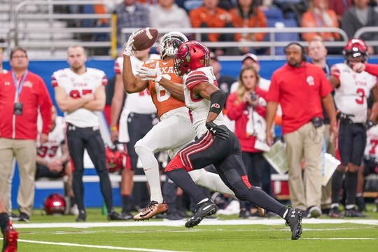 Dec 31, 2019; San Antonio, Texas, USA;  Texas Longhorns wide receiver Devin Duvernay (6) catches a pass with Utah Utes defensive back Javelin Guidry (28) during the first half at the Alamodome. Mandatory Credit: Daniel Dunn-USA TODAY Sports