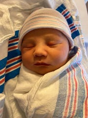 Baby Lucian was born just a minute after midnight on New Year's Day at Virtua Memorial Hospital at Mount Holly.