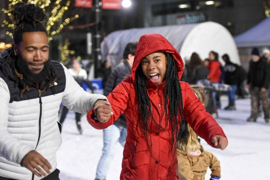 Thousands of fellow Cincinnatians started the new year and the decade at Fountain Square. The party featured ice skating, music, games, dance contest and a Rossi fireworks show at midnight. Daren and Sunni Love of Evanston.