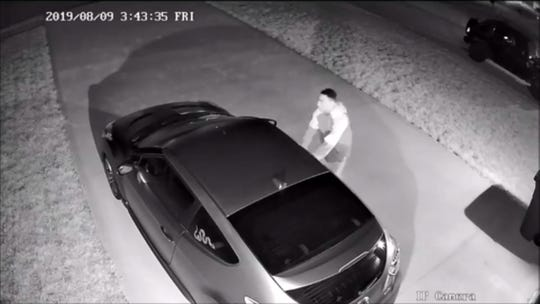 Video surveillance footage of a vehicle burglary suspect checking for unlocked car doors in Clarksville in August 2019.