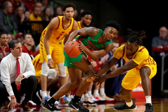 Florida A&M forward Bryce Moragne, center, regains control of the ball as Iowa State forward Solomon Young, right, defends during the first half of an NCAA college basketball game Tuesday, Dec. 31, 2019, in Ames, Iowa. (AP Photo/Matthew Putney)