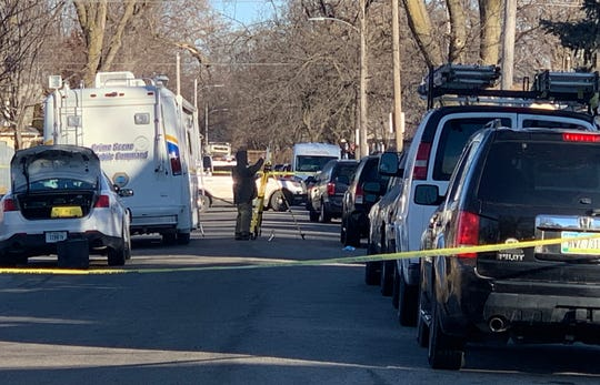 Police investigate the scene where a juvenile male was killed in the 1400 block of 17th Street in the early morning hours of Jan. 1, 2020.