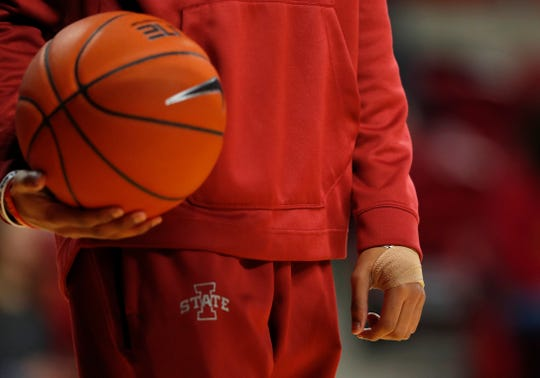 Iowa State guard Tyrese Haliburton tosses back loose balls as players warm up for an NCAA college basketball game against Florida A&M, Tuesday, Dec. 31, 2019, in Ames, Iowa. Haliburton was not scheduled to play due to a sprained left wrist. (AP Photo/Matthew Putney)