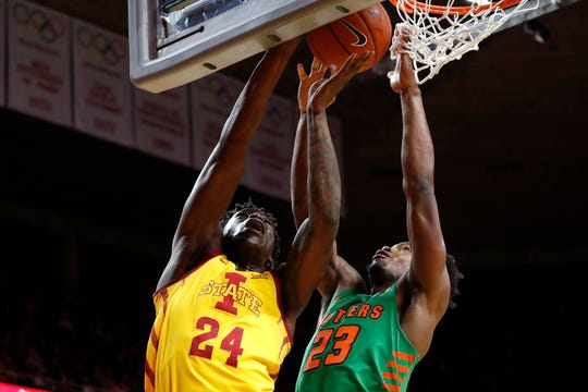 Iowa State guard Terrence Lewis, left, works for a layup as Florida A&M forward Bryce Moragne, right, defends during the first half of an NCAA college basketball game Tuesday, Dec. 31, 2019, in Ames, Iowa. (AP Photo/Matthew Putney)