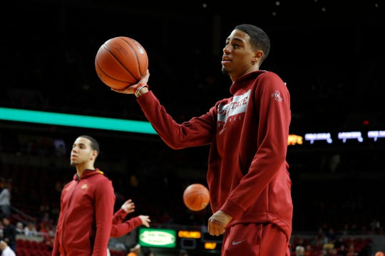 Iowa State guard Tyrese Haliburton tosses back loose balls during warm ups before the team's NCAA college basketball game against Florida A&M, Tuesday, Dec. 31, 2019, in Ames, Iowa. Haliburton was not scheduled to play due to a sprained left wrist. (AP Photo/Matthew Putney)