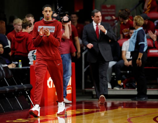 Iowa State guard Tyrese Haliburton, left, enters the court in front of coach Steve Prohm, right, before the team's NCAA college basketball game against Florida A&M, Tuesday, Dec. 31, 2019, in Ames, Iowa. Haliburton was not expected play due to a sprained left wrist. (AP Photo/Matthew Putney)