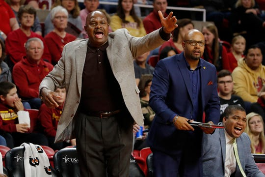 Florida A&M coach Robert McCullum, left, directs his players against Iowa State during the first half of an NCAA college basketball game Tuesday, Dec. 31, 2019, in Ames, Iowa. (AP Photo/Matthew Putney)