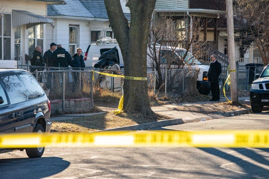 Police investigate the scene where a Josiah Woods, who was 14, was shot and killed on the 1400 block of 17th Street Wednesday, Jan. 1, 2020.
