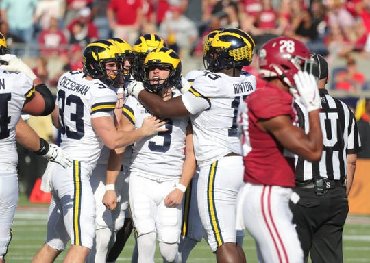 Michigan kicker Quinn Nordin celebrates his field goal during the first half of the Citrus Bowl  on Wednesday, Jan. 1, 2020, in Orlando, Florida.