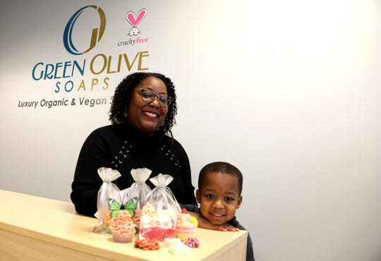 Camilla Rice, 42, with son Miles at her store, Green Olive Soaps, in Troy , Mich., on Dec. 31, 2019. Rice, an engineer at Ford Motor Co., started the soap store because Miles has eczema and the soaps she was buying for him were very expensive.
