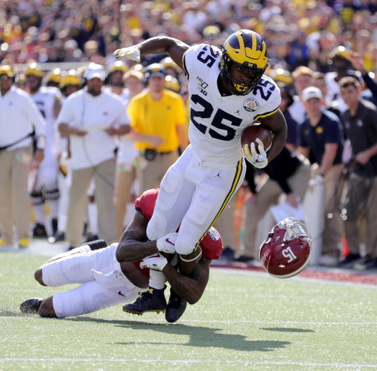 Michigan running back Hassan Haskins is tackled by Alabama defensive back Xavier McKinney during the first half of U-M's 35-16 loss in the Citrus Bowl on Wednesday, Jan. 1, 2020, in Orlando, Florida.