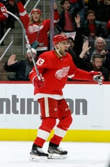 Detroit Red Wings defenseman Trevor Daley (83) celebrates a goal against the San Jose Sharks by left wing Tyler Bertuzzi during the second period of an NHL hockey game Tuesday, Dec. 31, 2019, in Detroit. (AP Photo/Duane Burleson)