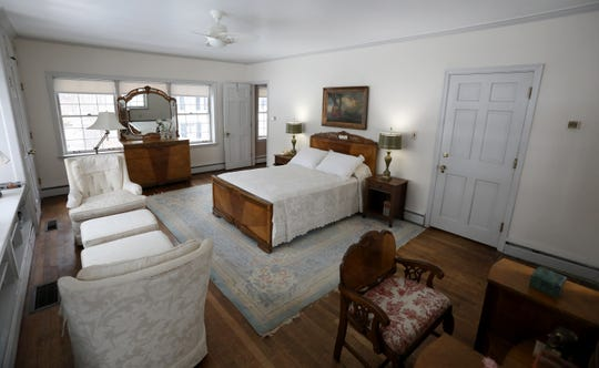 One of two possible owners' suites, this large bed-bath combination is a corner room with two walls of windows. Under the windows at left are bookcases and a window seat.   Photographed on Tuesday, December 31, 2019.