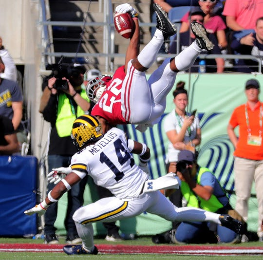 Michigan's Josh Metellus tackles Alabama's Najee Harris as he dives into the end zone during the first half of U-M's 35-16 loss in the Citrus Bowl on Wednesday, Jan. 1, 2020, in Orlando, Fla.