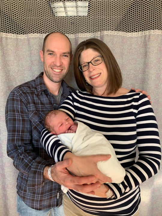 Parents Becky and Mark Stouffer with their newborn son Levi James Stouffer
