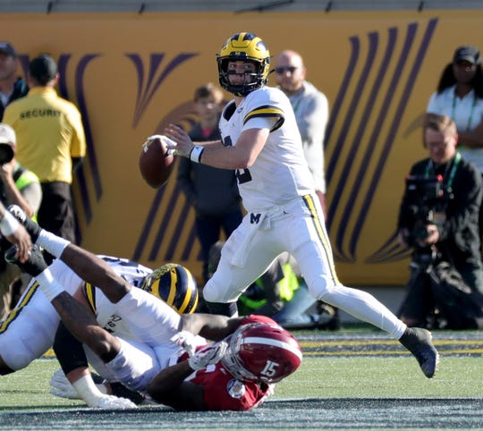 Michigan quarterback Shea Patterson passes against Alabama during the second half of the Citrus Bowl, Wednesday, Jan. 1, 2020 at Camping World Stadium in Orlando, Fla.