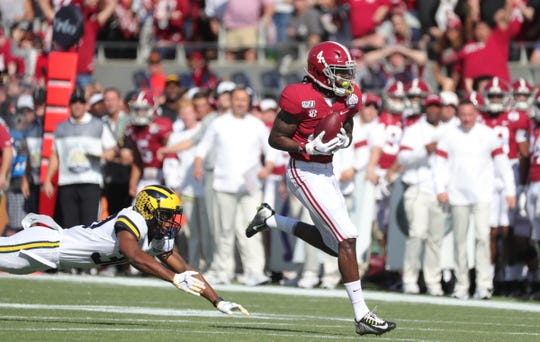 Michigan's Daxton Hill gives up a touchdown to Alabama's Jerry Jeudy during the first half.