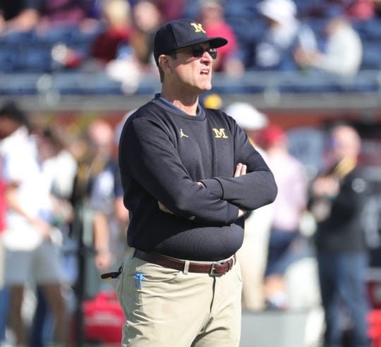 Michigan coach Jim Harbaugh watches his team warm up before action against Alabama in the Citrus Bowl on Wednesday, Jan. 1, 2020, in Orlando, Florida.