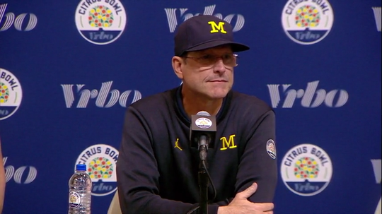 Michigan Wolverines football coach Jim Harbaugh speaks to the media after the 35-16 loss to Alabama in the Citrus Bowl on Jan. 1, 2020, in Orlando.