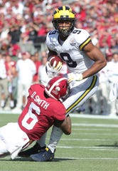 Donovan Peoples-Jones is tackled against Alabama on Wednesday.
