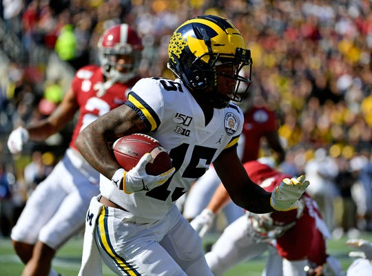 Michigan wide receiver Giles Jackson runs with the ball on the opening kickoff against Alabama during the first half of the Citrus Bowl on Wednesday, Jan. 1, 2020, in Orlando, Florida.