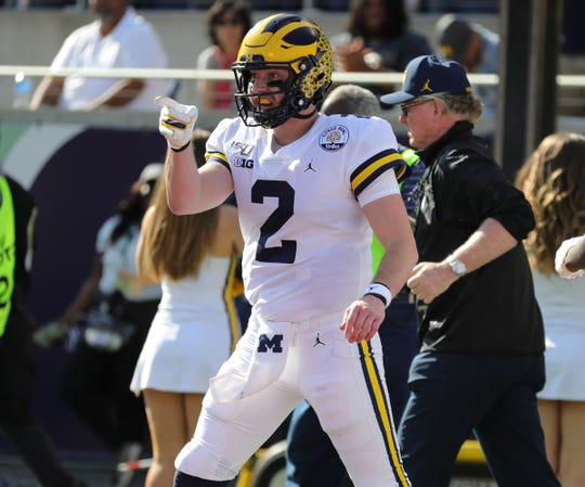 Michigan quarterback Shea Patterson celebrates a touchdown against Alabama during the first half of U-M's 35-16 loss in the Citrus Bowl on Wednesday, Jan. 1, 2020, in Orlando, Florida.
