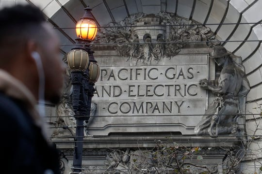 A sign to a Pacific Gas & Electric building is shown in San Francisco, Monday, Dec. 16, 2019.