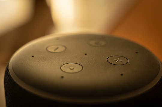 An Amazon Echo Dot placed in a living room. Apple, Google and Amazon have announced the formation of a group called Project Connected Home over IP.