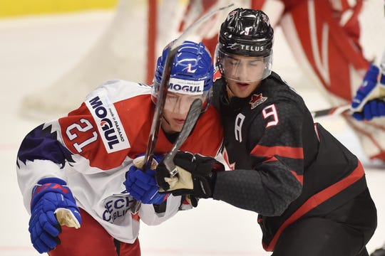 Red Wings draft pick Joe Veleno, right, is checked by forward Jaromir Pytlik of the Czech Republic in Ostrava on Tuesday.