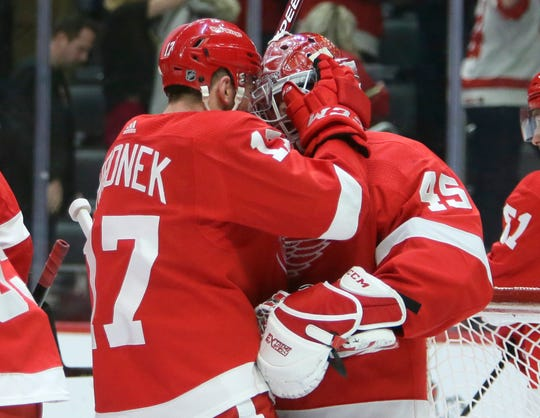 Detroit Red Wings defenseman Filip Hronek celebrates with goaltender Jonathan Bernier after the win on Tuesday night.