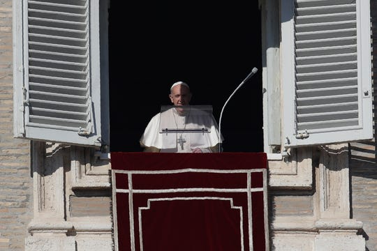 Pope Francis recites the Angelus prayer from his studio's window overlooking St. Peter's square at the Vatican on Wednesday.