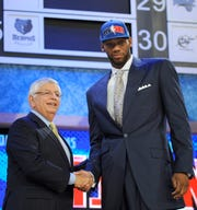 NBA commissioner David Stern, left, poses with Georgetown forward Greg Monroe, who was selected seventh overall by the Detroit Pistons in the first round in 2010.